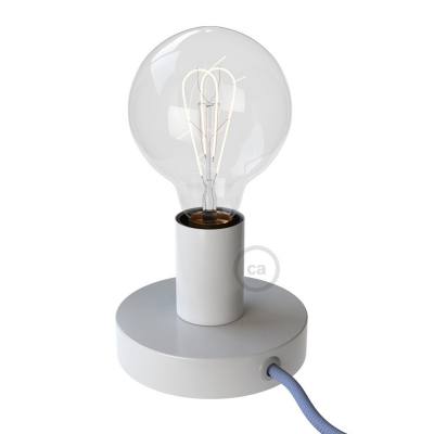 Posaluce, the white metal table lamp, with textile cable, switch and plug
