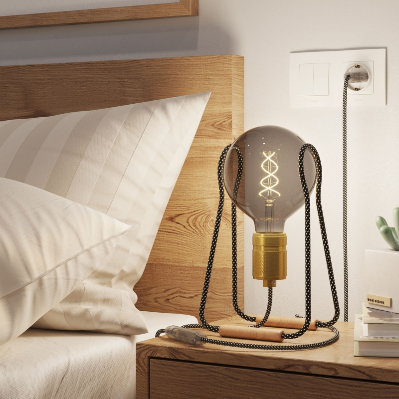 Taché, light bulb support